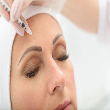 64108734-close-up-of-senior-woman-face-getting-botox-injection-at-clinic-her-eyes-are-closed-with-serenity-1
